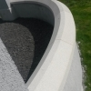 Curved granite capping